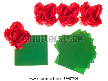 Origami flower red roses and green paper isolated on white