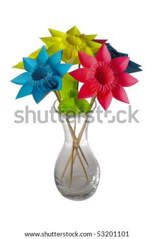 Origami flowers in glass vase isolated on white.