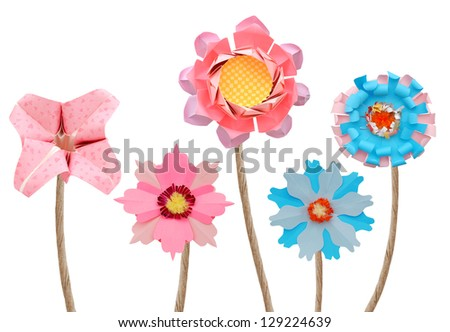 Origami flowers on white background