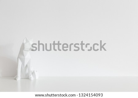Origami fox design sculpture home decor near white wall mock up.