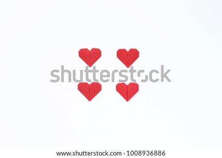 Origami hearts on a white background. Image for a gift card for the day of Valentine's Day. Minimalism