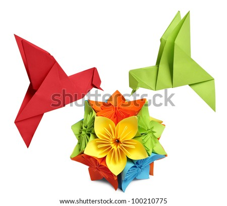 origami hummingbird over flower kusudama over white background