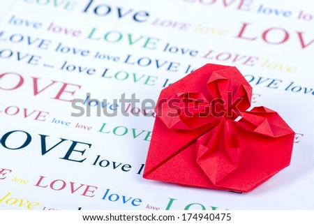 origami love shape on colorful love text background