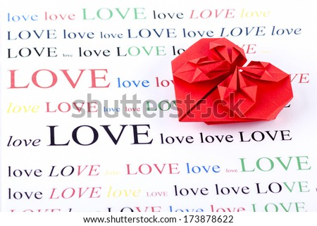 origami love shape on love text background