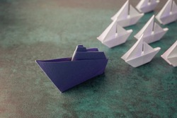Origami paper ship boats, success leadership, strategy planning development, social media influence marketing, HR recruiter, disruptive innovation, breakthrough business model solutions concept