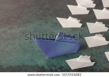 Origami paper ships, leadership business concept #1015416082