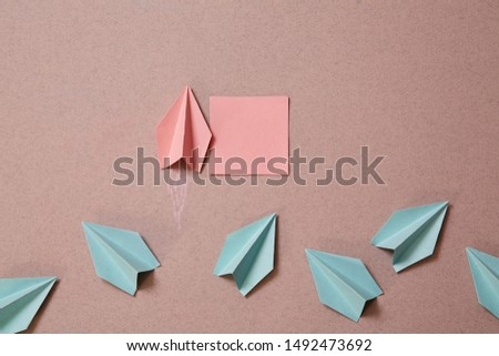 Origami plane with sticker for inscription. Business original idea, individuality and creativity.