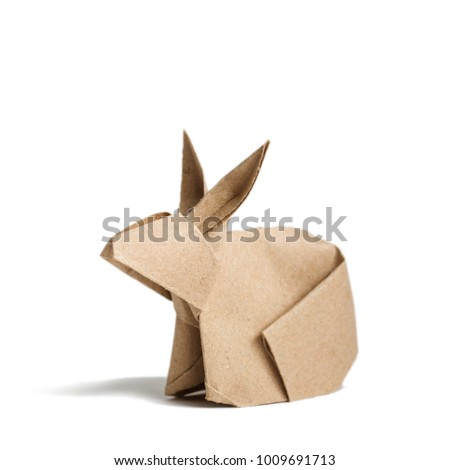 origami rabbit from recycled paper. Easter bunny. Isolated on white background
