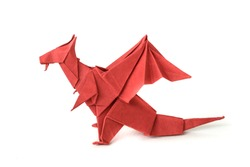 Origami - red dragon on isolated white background. Paper craft. Dragon of paper.