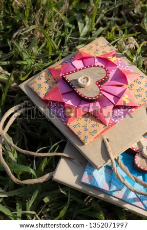 origami to decorate paper bag with floral patterns. Mother's day gift. Female.