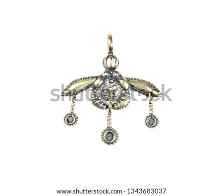 Original bee pendant from Crete, isolated on white
