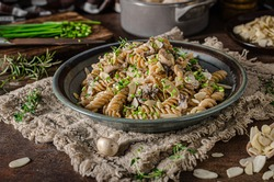 Original creamy pasta with mushrooms, herbs and almond slices