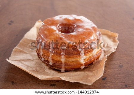 Original croissant and doughnut mixture on a wooden table