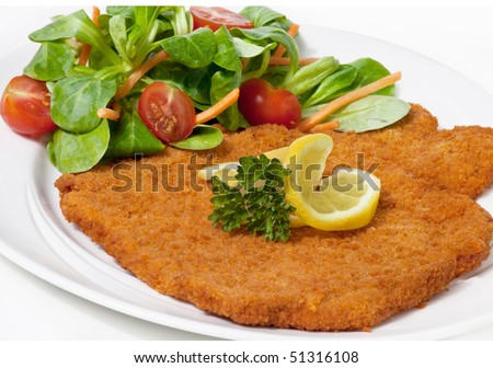 Original fried breaded Veal Viennese with Salad (could be either veal, pork or chicken schnitzel)