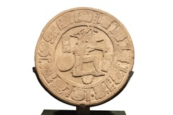 Original Mayan engraved round stone. Chiapas, Mexico (AD, 591) This bass relief disc shows a ball player in the action of hitting the giant ball with his hip.