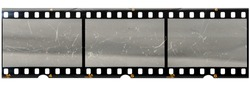 original 35mm filmstrip with empty dusty frames or cells and nice texture on the border, fluffs on film material, real film grain