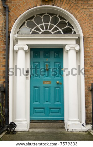 Original turquoise colored door in Georgian Dublin - stock photo