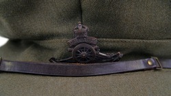 Original WW1 British Royal Artillery Officers Trench Cap. Soft khaki trench cap designed for comfort in the front line. With bronze Royal Artillery cap badge and brass buttons, plus leather chin strap
