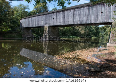 Originally built in 1873 and rebuilt in 1997 after a 1991 fire, the Schofield Ford Covered Bridge was constructed with native hemlock and oak. It is only accessible by foot, bike or horseback.  Stockfoto ©