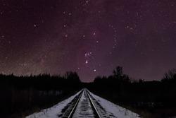 Orion constellation over train tracks