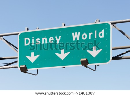 ORLANDO - DECEMBER 22: A sign in Orlando, FL points to the Walt Disney World Resort on December 22, 2011. With more than 47 million visitors in 2010, it is world's most visited entertainment resort.