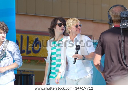 ORLANDO, FL - MARCH 28; Ellen Degeneres and Jonas Brothers during the taping of her show at Universal Studios CityWalk. March 28, 2008 - stock photo