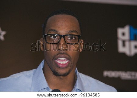 ORLANDO, FLORIDA - FEB. 24: Basketball star Dwight Howard attends the VIP All-Star party hosted by him and Adidas.  Feb. 24, 2012 in Orlando Florida. - stock photo