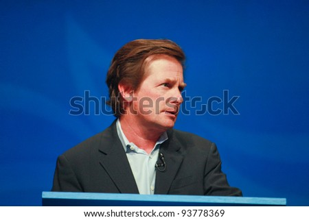 ORLANDO, FLORIDA - JANUARY 16: Actor Michael J. Fox delivers an address to IBM Lotusphere 2012 conference on January 16, 2012 in Orlando, FL. He tells how social networks help him fight his Parkinson disease - stock photo