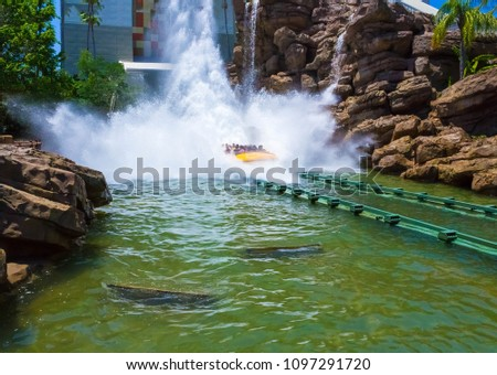 Orlando, Florida, USA - May 09, 2018: The people resting at Jurassic Park River Adventure in the Jurassic Park area of Universals Island of Adventure #1097291720