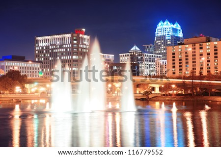 Orlando Lake Lucerne panorama at night with office buildings, bridge and fountain