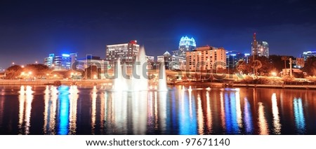 Orlando Lake Lucerne panorama at night with office buildings, bridge and fountain - stock photo