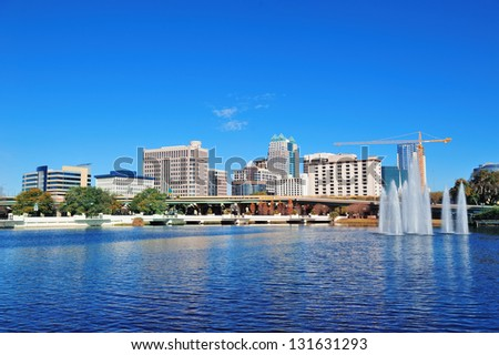 Orlando Lake Lucerne panorama in the morning with office buildings, bridge and fountain