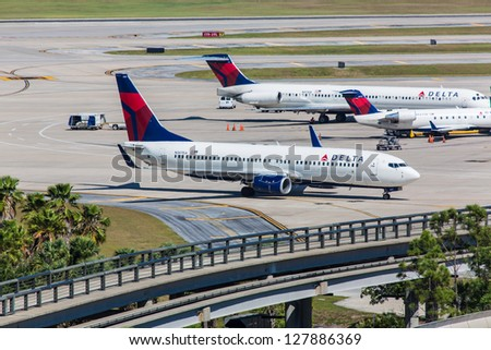 ORLANDO - SEPTEMBER 4: Boeing 737 and 757 Delta parked on Orlando International Airport on September 4, 2012. MCO is a major international airport in Orlando and the second-busiest airport in Florida