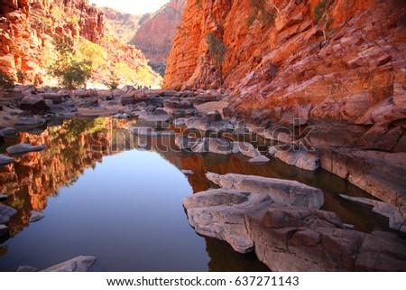 Ormiston Gorge in the West MacDonnell Range reflected in a pool of water. #637271143