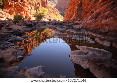 Ormiston Gorge in the West MacDonnell Range reflected in a pool of water. #637271146