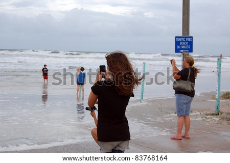 ORMOND BEACH, FL - AUGUST 25: Residents take photos as the ocean breaches the beach driving ramp as Hurricane Irene passes off the coast on August 25, 2011 in Ormond Beach, Florida .