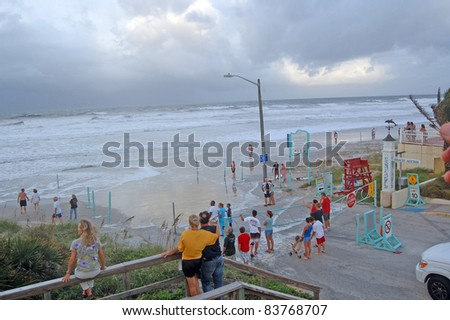 ORMOND BEACH, FL - AUGUST 25: Residents watch the ocean breach the beach driving ramp as Hurricane Irene passes off the coast on August 25, 2011 in Ormond Beach, Florida .
