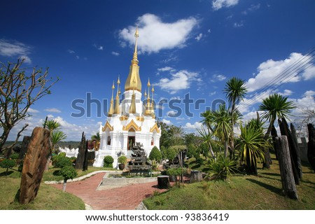 Ornament: beautiful white and gold pagoda architecture at wat Tham Kuha Sawan at Ubon Ratchathani province, Thailand - stock photo