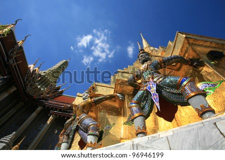 Ornament: hanuman statues attached on gold pagoda surface at Wat Phra Kaew, Thailand