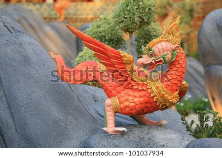 Ornament: red animal sculpture like chicken standing on artificial rock at Royal funeral pyre for cremation ceremony of the HRH Princess Bejaratana Rajasuda at Sanam Luang in Bangkok