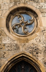 Ornamental cound window on the wall of the cathedral in Bad Urach in South Germany
