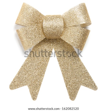 Ornamental decoration bow tie for Christmas presents, gold, shiny, sparkling. Isolated on white background.