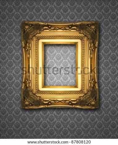 Ornamental gold frame on damask wallpaper, similar available in my portfolio