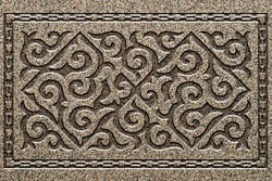 Ornamental print on the stone surface. Vintage ornament on the stone. Close-up seamless texture. Stone texture. Pattern on the stone. Embossed pattern. Wallpaper.