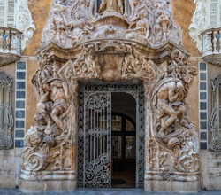 Ornate alabaster stone facade of the historic Palace of Marques de Dos Aguas national ceramic museum in Valencia, Spain.