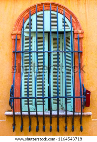 Ornate Arched Window with ornate bars #1164543718