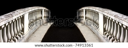 Ornate bridge to nowhere on black