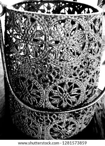 Ornate candle holder with handle