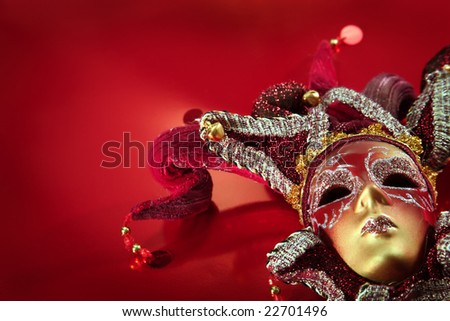 ornate carnival mask over textured metalic background