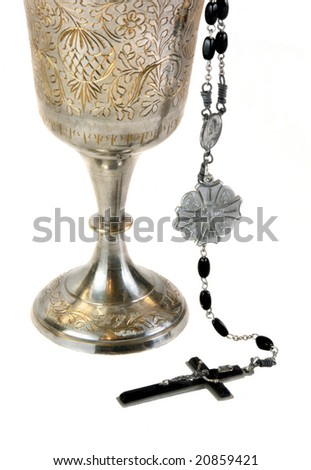 Ornate chalice for communion and a rosary.